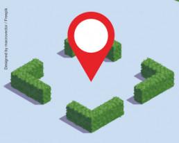 Standort in einem Quadrat mit grünen Hecken